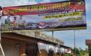 Kapolsek Cluring Pasang Baliho, Ajakan Sukseskan Pemilu 2019